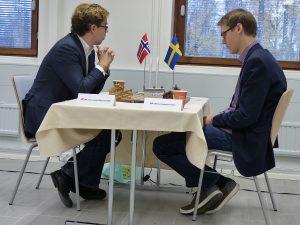 Jon Ludvig Hammer- Erik Blomqvist i rond 1. Foto NM-hemsidan